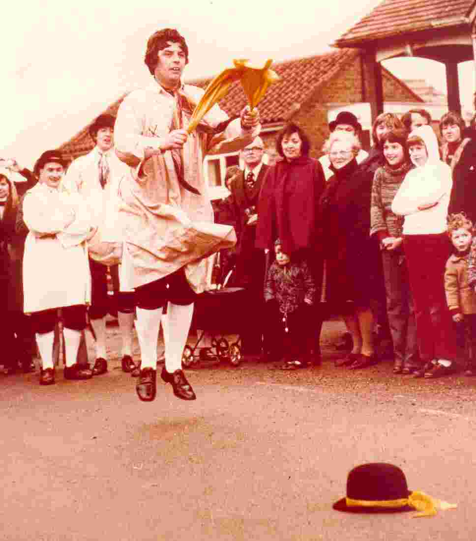 Derrek Leigh performing 'Lumps of Plum Pudding', a Bledington jig. On-looking admirers are Dave Lowe (left) and Terry Travis.